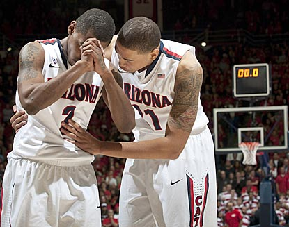 Mark Lyons (left) and Brandon Ashley see their prayer answered: Colorado's winning shot is nixed and Arizona capitalizes. (US Presswire)