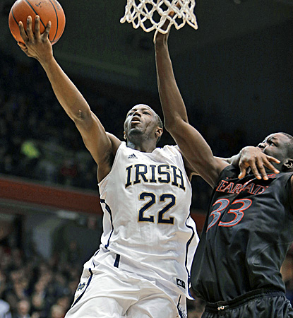 Notre Dame's Jerian Grant (left) drives against Cincinnati's David Nyarsuk for two of his 19 points. (AP)