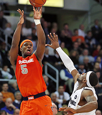 Syracuse's C.J. Fair, who scores 23  points and grabs 11 boards, shoots over Providence's LaDontae Henton. (AP)