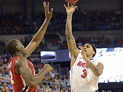 Mike Rosario's Gators improve to 7-0 in league openers under Billy Donovan. It's their 16th win in 19 meetings vs. Georgia. (AP)