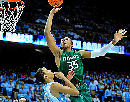 Miami's Kenny Kadji scores 18 points to go with 9 rebounds and 3 assists against North Carolina. (Getty Images)