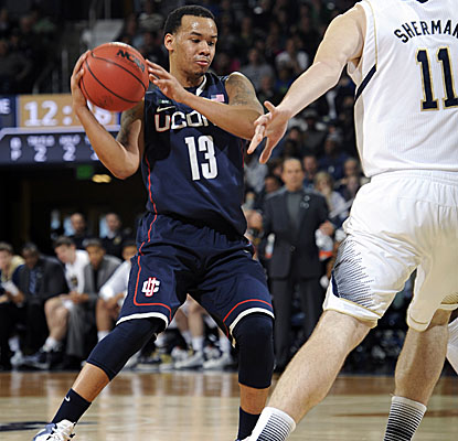 Shabazz Napier provides balance at guard for the Huskies, with 19 points, five boards and four assists in UConn's upset win. (AP)
