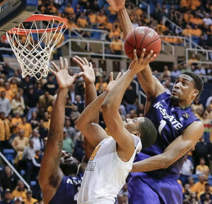 Shane Southwell rejects Gary Browne's layup with one second left to save the game for the Wildcats.  (AP)