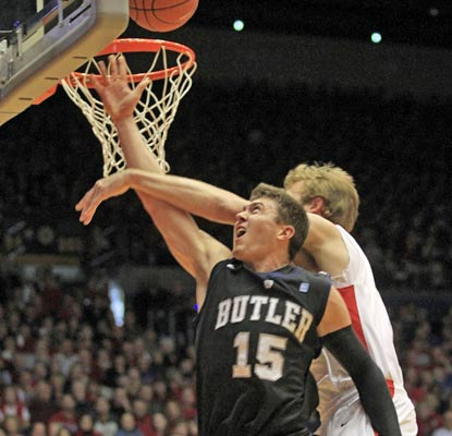 Butler loses Rotnei Clarke when he suffers a neck injury from this foul by Dayton's Matt Derenbecker.  (AP)