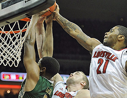Despite playing with braces on both ankles, Louisville forward Chane Behanan (21) came out with a spring in his step. (US Presswire)