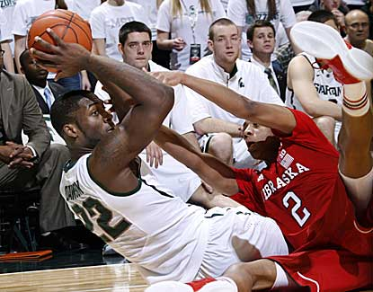Michigan State's Branden Dawson, who finishes with 12 points and 6 boards, looks to pass the ball. (AP)