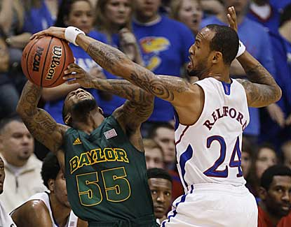 Kansas' Travis Releford (10 points, 2 assists), knocks the ball away from Baylor's Pierre Jackson. (AP)