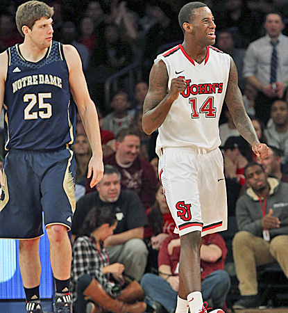 JaKarr Sampson (right), who scores 14 of his 17 points in the first half, is pleased after a call goes for St. John's. (AP)