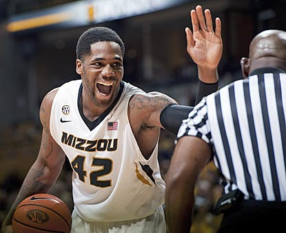 After getting fouled in the second half, Missouri's Alex Oriakhi unsuccessfully tries to high-five the ref making the call.  (AP)