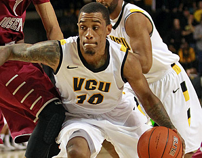Darius Theus scores a career-high 22 points to go with 10 assists and four steals for the Rams. (US Presswire)