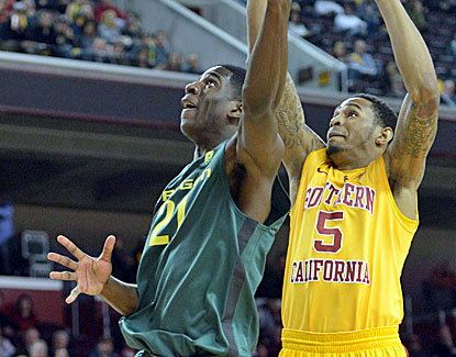 Oregon Ducks guard Damyean Dotson scores 2 of his 16 points against USC on Thursday night. (US Presswire)