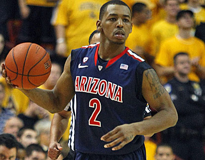 Mark Lyons, possibly the Pac-12's top point guard, scores 24 points in Arizona's win over Arizona State. (US Presswire)