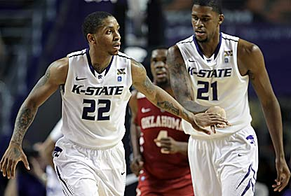 Rodney McGruder (left) -- who scores 20 points -- and Jordan Henriquez celebrate Kansas State's 8th straight win. (AP)