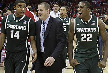 The Spartans celebrate after grinding it out to win their second straight at the Kohl Center. (AP)