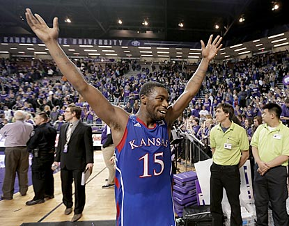 Elijah Johnson celebrates the Jayhawks' 28th victory in their past 30 games in the Little Apple.  (AP)