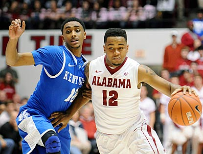Alabama guard Trevor Releford, who winds up with 13 points, drives past Kentucky's Ryan Harrow during the second half.  (US Presswire)