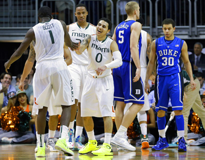 Miami's Shane Larkin (right) celebrates after Durand Scott (left) scores against Duke during a dominating first half. (AP)