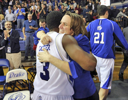 Drake guard Richard Carter, who scores a team-high 20 points, embraces by athletic director Sandy Hatfield Clubb after the win. (AP)