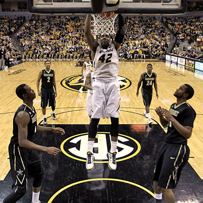 Vandy's four-corners defense against Alex Oriakhi can't stop this dunk as the Mizzou big man scores 18 points.  (Getty Images)