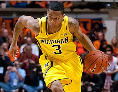 Trey Burke scores 19 points for No. 2 Michigan as the Wolverines never trail against Illinois. (US Presswire)