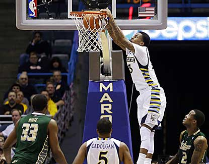 Marquette's Vander Blue throws down a dunk en route to 30 points and a 13-point victory over South Florida. (AP)