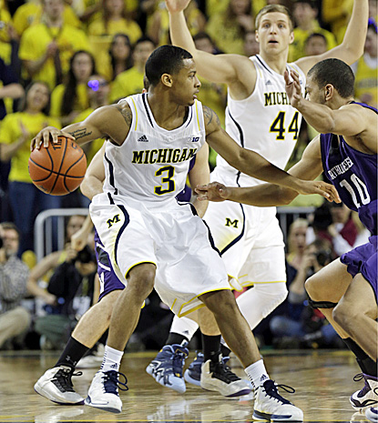 Trey Burke, who scores 18 points and dishes out eight assists, looks to pass against Northwestern. (AP)