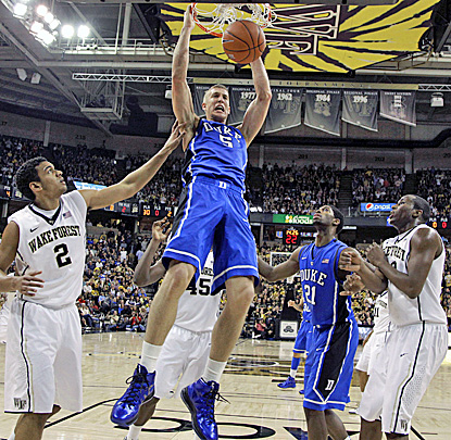 Mason Plumlee slams two of his career-high 32 points in the Blue Devils' five-point win over the Demon Deacons. (AP)