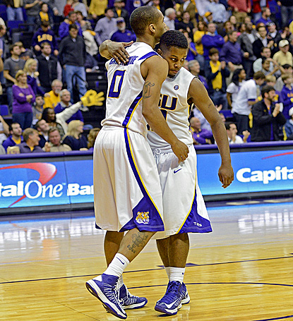 LSU's Charles Carmouche (left) embraces Andre Stringer following LSU's big win over No. 17 Missouri. (AP)
