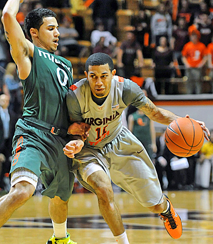 Shane Larkin (left), who scores a team-high 25 points for Miami, defends Virginia Tech's Erick Green in the Hurricanes' win. (AP)