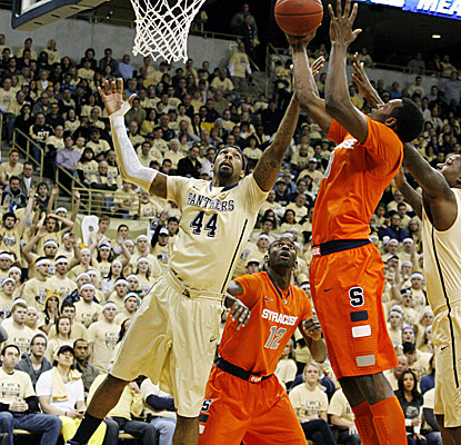 Sixth-ranked Syracuse loses the rebounding battle in Pittsburgh, fielding just 21 to the Panthers' 37. (AP)
