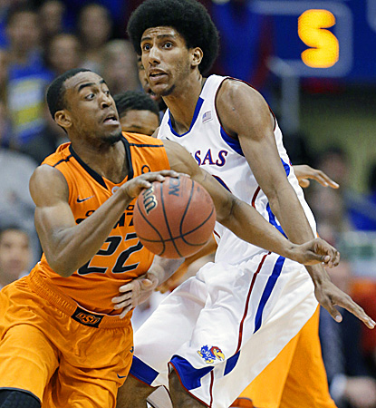 Markel Brown goes in for two of his 28 points as the Cowboys stun the Jayhawks at home. (AP)