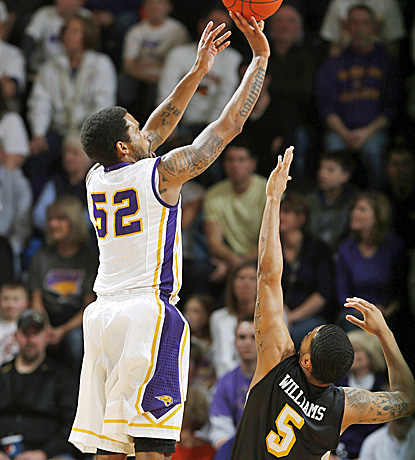 Northern Iowa's Anthony James (left) shoots over Wichita State's Demetric Williams for two of 16 points. (AP)