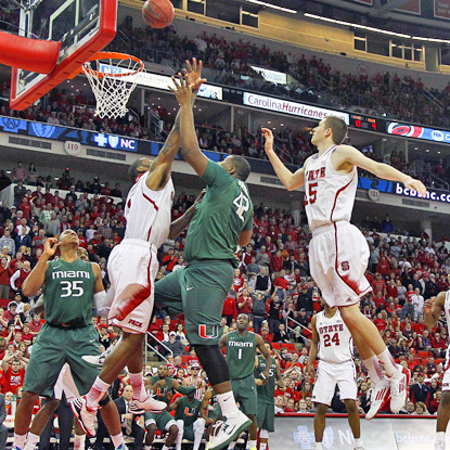 Reggie Johnson (second from right) tips in the winning basket with 0.8 seconds remaining to beat N.C. State in Raleigh. (AP)