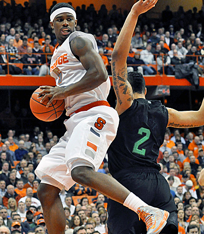 C.J. Fair, who scores 18 points, pulls down one of his 10 rebounds in Syracuse's win over Notre Dame in the Carrier Dome.  (AP)