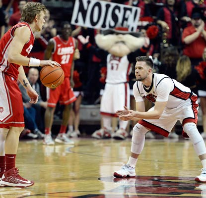 Katin Reinhardt and the Runnin' Rebels play some tight defense, holding the Lobos to 34 percent shooting.  (US Presswire)