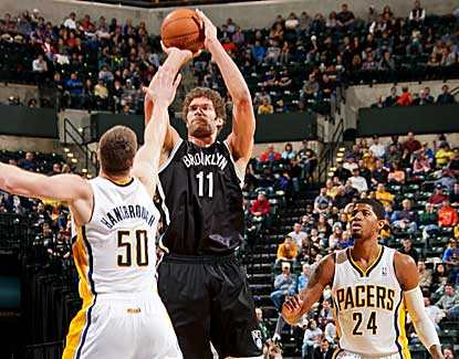 Brook Lopez shoots over Tyler Hansbrough during his 25-point performance against the Pacers. (Getty Images)