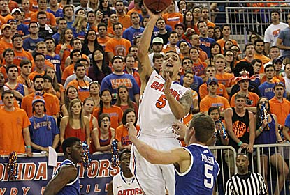 Scottie Wilbekin scores 14 points to go with eight assists for the Gators, who beat the Cats for the first time in two years. (US Presswire)
