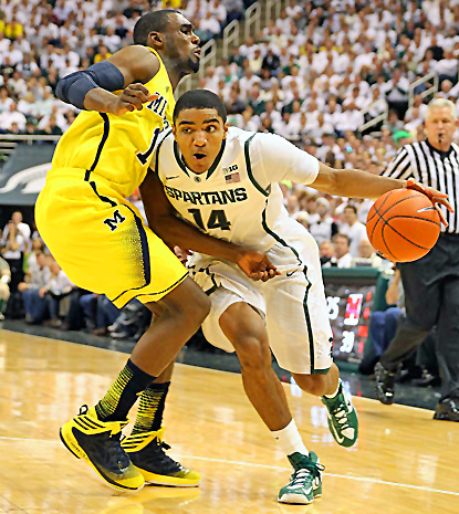 Gary Harris (right), who scores 17 points to lead the Spartans, drives past Michigan's Glenn Robinson III. (US Presswire)