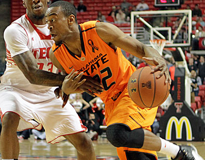 Oklahoma State's Markel Brown scores 25 points and matches a career high with seven 3-pointers, all in the first half. (US Presswire)