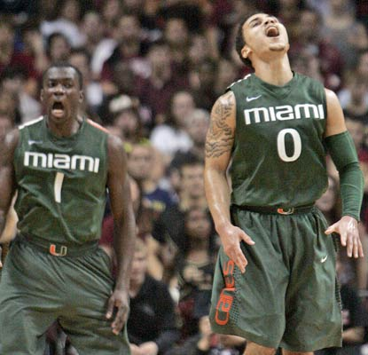 Durand Scott (left), Shane Larkin and the Canes are the first to start 11-0 in the ACC in 12 years.  (AP)