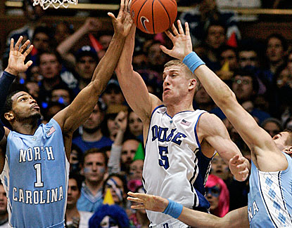 Duke center Mason Plumlee scores 18 points and grabs 11 rebounds to help the Blue Devils get past rival North Carolina. (US Presswire)