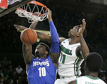 Memphis' Tarik Black throws down the dunk as the Tigers extend their winning streak to 16 games. (AP)