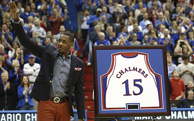 Kansas retires the jersey of former guard Mario Chalmers before the Jayhawks' game against Texas. (AP)