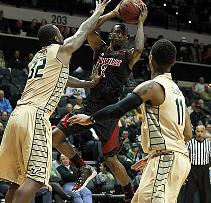 Russ Smith finishes with a game-high 15 points for the Cardinals, going 7-for-7 from the free-throw line. (US Presswire)