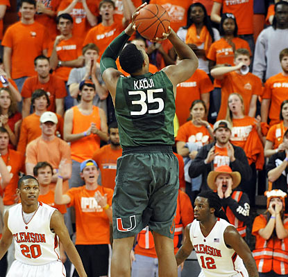Kenny Kadji helps Miami survive an ugly effort with this key go-ahead 3 with 36 seconds left in the contest. (AP)