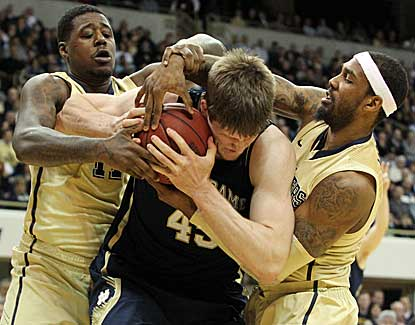 Notre Dame's Jack Cooley, center, scores 13 points with 9 rebounds to lead the Irish past Pitt. (US Presswire)