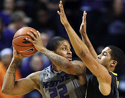 No. 14 Kansas State defeats West Virginia in a physical game, with the officials calling 49 combined fouls. (AP)