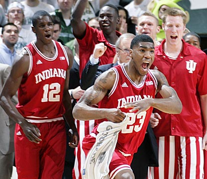 Remy Abell (23) leads the cheers for Indiana after the top-ranked Hoosiers break a 17-game losing streak in East Lansing.  (AP)