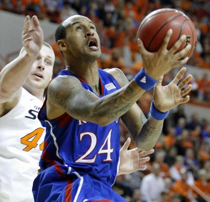 Travis Releford tallies 18 points as Kansas seeks at least a share of the Big 12 regular-season title. (USATSI)