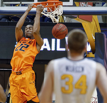 OK State finds its groove in the second half, where it outscores cold-shooting West Virginia 38-24. (AP)